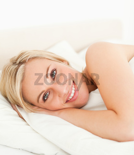 Close up of a serene woman opening her eyes