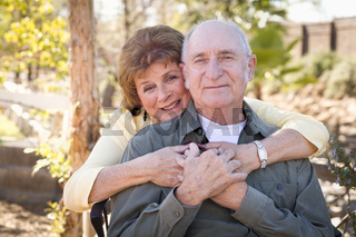 Happy Senior Couple Relaxing in The Park