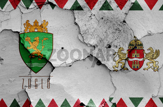 flags of District XIV. (Zuglo) and Budapest painted on cracked wall