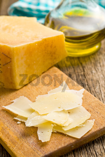 pieces of Italian hard cheese on a wooden table