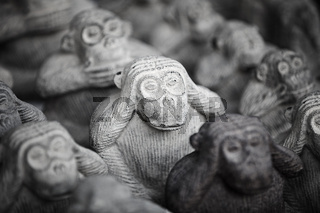 Stone miniature figurines of monkeys