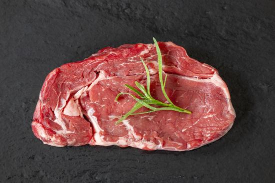 raw steak on black slate