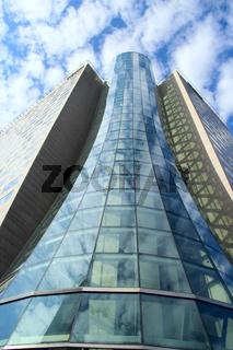 High glass skyscraper in Warsaw. Modern architecture of city buildings