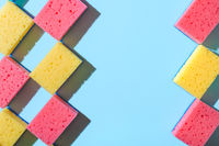 House cleaning sponges on blue background