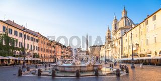 Sunrise light on Piazza Navona (Navona Square) buildings in Rome, Italy