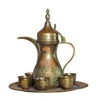 Turkish coffee set: Ottoman ornate coffee pot and ornate cups isolated on white with clipping path