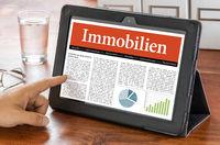 A tablet computer on a desk - Real Estate - Immobilien German