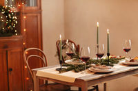 Candles and wine on Christmas table