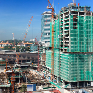 Building house constraction site with cranes. Square format
