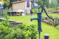 Water supply urban gardening: Well for watering vegetables, herbs and fruits in. Vegetable patch.