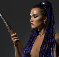 Horsewoman with dreadlocks topless profile view