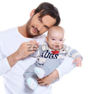 Proud young father posing with his baby