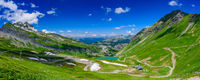 Panoramic landscape of mountains of Alps in summer with a lake in Portes du Soleil, France, Europe