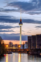 The skyline of Berlin with the famous TV Tower and the river Spree after sunset