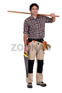 Carpenter with saw and plank of wood