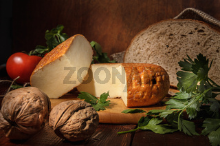 circle of cheese on a cutting board in a rustic style