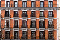 Elevation View of Old Luxury Residential Building with Brick Facade and Balconies