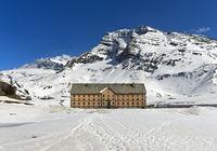 Simplon hospice on the Simplon Pass in winter, Valais, Switzerland