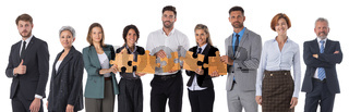 Business people with pieces of puzzle