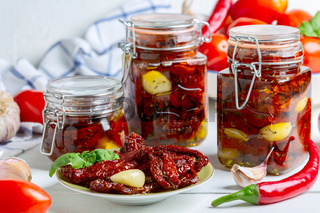 Dried tomatoes with herbs and olive oil.