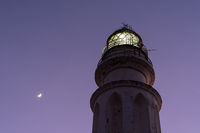 close up view of the Cape Trafalgar Lighthouse and a new moon