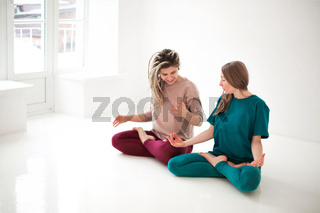 Women practicing yoga at home