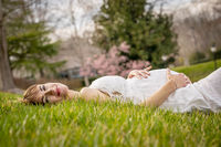 A Gorgeous Glowing Pregnant Woman Poses In An Outdoor Environment