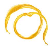 Circle orange juice splash isolated on white background