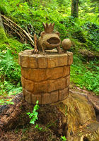 Wooden sculpture frog prince in the fairy tale forest, black forest, germany