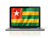 Togo flag on laptop screen isolated on white. 3D illustration
