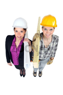 Engineer and construction worker side-by-side