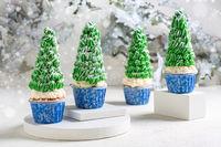 Christmas cupcakes with Christmas tree decor.