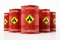 Red barrels with caution flammable warning text and fire symbol isolated on white background. 3D illustration