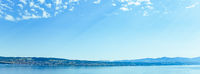 Lake Zurich in Wollerau, canton of Schwyz in Switzerland, Zurichsee, Swiss mountains landscape, blue water and sky in summer, idyllic nature and perfect travel destination, ideal as scenic art print
