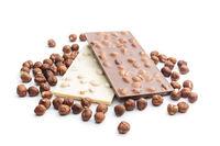 White and dark chocolate bars with hazelnuts.