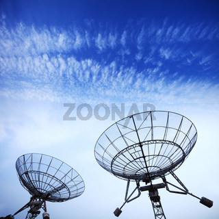 satellite dishes with blue sky