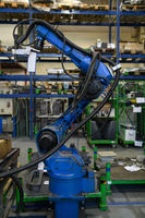 Automatic welding robot mechanical arm is working in the modern automobile parts factory.