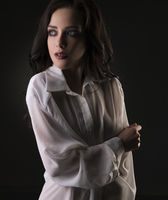 Sexy brunette in shirt cropped view in dark room