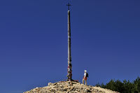 Spain: Pilgrim at iron cross of Monte Irago