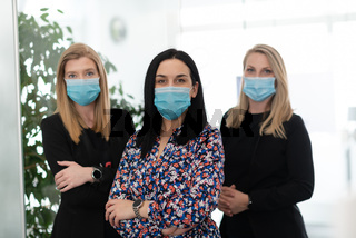 business team in protective medical mask at modern office