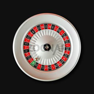 Casino roulette wheel isolated on Black background