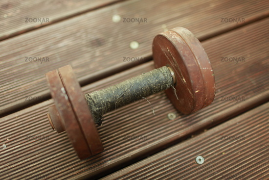old heavy steel dumbbell close-up