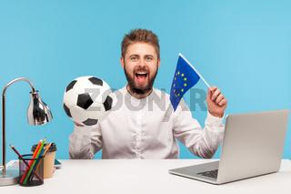Emotional businessman working on laptop on blue background.