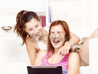 happy teenage girls using touchpad
