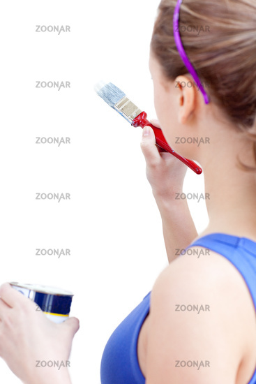 Young woman using a paintbrush