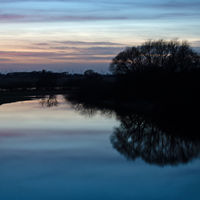 The river Aller near the city of Verden at blue hour, Lower Saxony, Germany