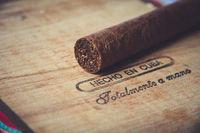 Cuban cigar on vintage wooden box