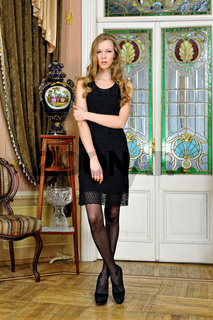 Beautiful woman in luxurious antique interior.