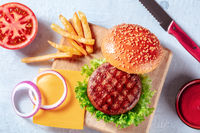 Burger ingredients, overhead flat lay shot with French fries