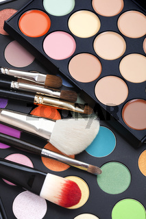 set colorful of makeup pallet with makeup brushes